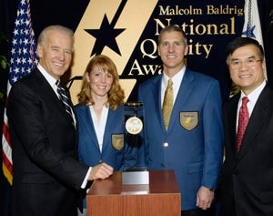 (From left to right) United States Vice President Joe Biden;  Matt Fleming, MidwayUSA President; Deanna Herwald, MidwayUSA VicePresident of Quality Management Services; and United States Commerce Secretary Gary Locke.