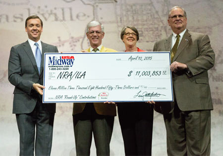 L-R: Chris Cox Executive Director of NRA-ILA, Larry and Brenda Potterfield, and Jim Porter, NRA President